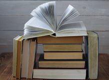 Open book on a pile of books royalty free stock images