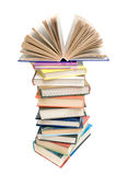 Open book on a pile of books on a white background. Open book on a pile of books of various isolated on white background close-up Royalty Free Stock Photography