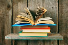 The open book on a pile from books. Royalty Free Stock Images