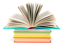 The open book on a pile of multi-coloured books. Royalty Free Stock Image