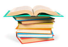The open book on a pile of multi-coloured books. Stock Photography