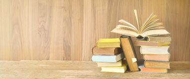 Open Book on a pile of old books, panoarma, good copy space royalty free stock photos