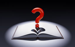 Open book with question mark in the spot of light Royalty Free Stock Images