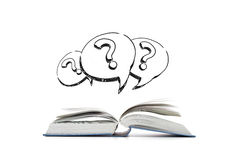 Open book and question marks in text bubbles Stock Photo