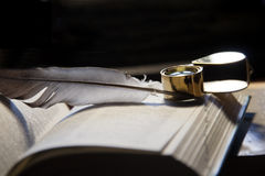 Open book and quill pen Royalty Free Stock Photos