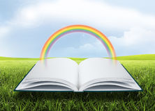 Open book with rainbows Royalty Free Stock Image