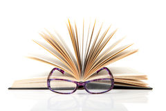 Open book with reading glasses Royalty Free Stock Images