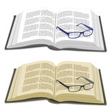 Open book and reading glasses Stock Images