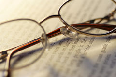 Open book and reading glasses Royalty Free Stock Image