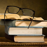 Open book with reading glasses Stock Photo
