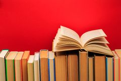 Open book on the red  background. Image stock photography
