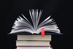 An open book with a red bookmark royalty free stock photography