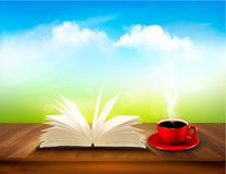 Open book and red cup on a wooden deck Royalty Free Stock Photo