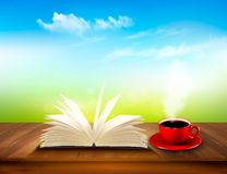 Open book and red cup on a wooden deck Royalty Free Stock Image