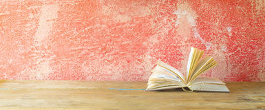 Open book on red grungy background, Stock Image