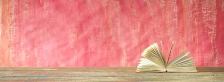 Open book on red grungy background, good copy space Stock Photos