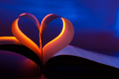 Open book in red heart shape Royalty Free Stock Images