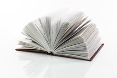 Open book. Reflected on white background Royalty Free Stock Images