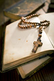 Open book with rosary beads Stock Image