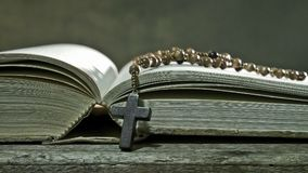 Open Book with Rosary Stock Images