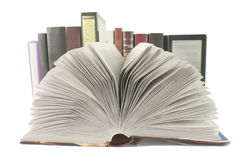 Open book with a row of books and ebook behind it Royalty Free Stock Images