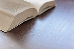 Open book on a rustic wooden table Royalty Free Stock Images