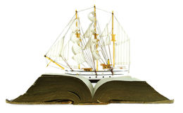 Open book and sailing ship isolated Stock Images