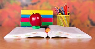 Open book and school accessories Royalty Free Stock Photos