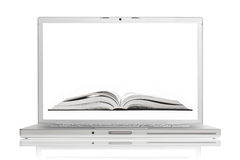 Open book on screen of high-end aluminium laptop Royalty Free Stock Images