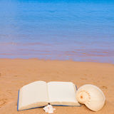 Open book on a sea shore Stock Image