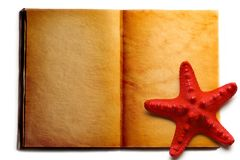 Open book and seastar Stock Photo