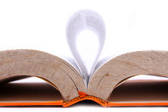 An open book with sheet forming waves. On a white background Royalty Free Stock Photo