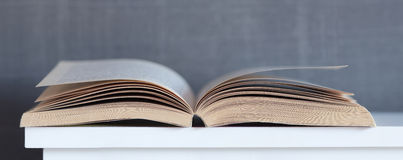 Open Book. On a Shelf with selective focus Stock Photography