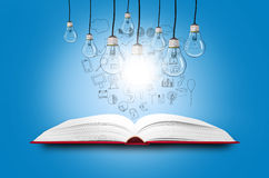 Open book. With shining lamps Stock Images