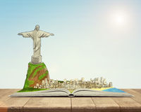 Open book with sketch of the Christ the Redeemer statue and Rio de Janeiro Royalty Free Stock Images