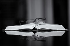 Open Book and spectacles Royalty Free Stock Images