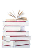Open book on stack of books. Royalty Free Stock Photo