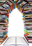 Open book and a stack of books in the form of windows, doors, frames Royalty Free Stock Photo