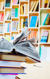 Open book on a stack of books Stock Images
