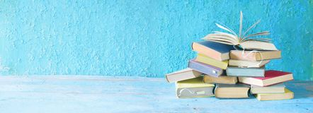 Open book on an stack of books. royalty free stock photo