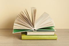 Open book on stack of books on wooden table. Education background. Back to school. stock photo