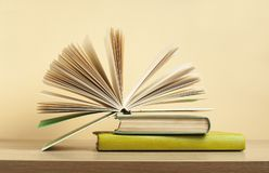 Open book on stack of books on wooden table. Education background. Back to school. stock photography