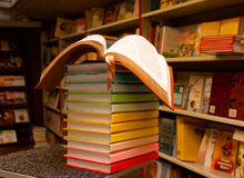Open book on the stack of colorful books Royalty Free Stock Image