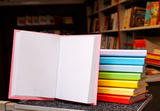 Open book with a stack of colorful books Royalty Free Stock Photo
