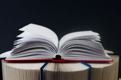 Open book, stack of hardback books. Back to school. Copy space.  stock photography