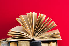 Open book, stack of hardback books. Back to school. Copy space.  Royalty Free Stock Photos