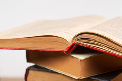 Open book, stack of hardback books. Back to school. Copy space Stock Photos