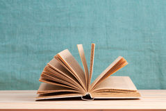 Open book, stack of hardback books on wooden table. Back to school. Copy space.  royalty free stock photos