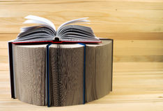 Open book, stack of hardback books on wooden table. Back to school. Copy space.  Royalty Free Stock Photo