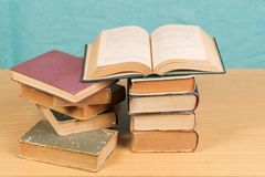 Open book, stack of hardback books on wooden table. Back to school. Copy space Royalty Free Stock Image